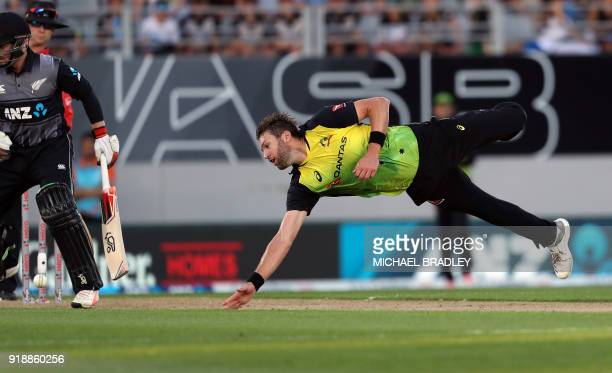 Australia's Andrew Tye dives unsuccessfully to take a catach during the Twenty20 Tri Series international cricket match between New Zealand and...