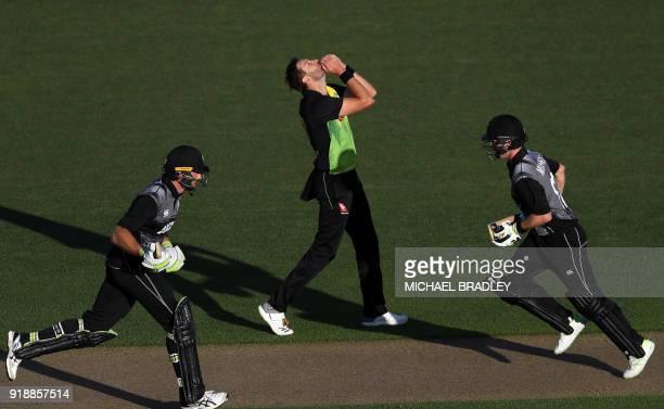 Australia's Andrew Tye reacts as New Zealand's Martin Guptill and Colin Munro make runs during the Twenty20 Tri Series international cricket match...