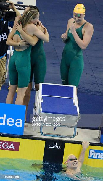 Australia's Angie Bainbridge Blair Evans Kylie Palmer and Bronte Barratt react after they competed in the final of the women's 4x200metre freestyle...
