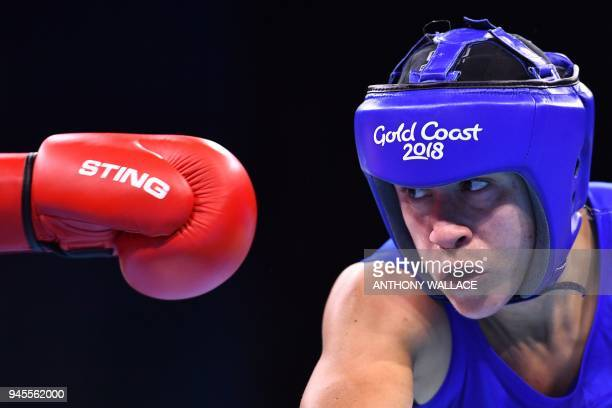 Australia's Anja Stridsman aims a punch at New Zealand's Troy Garton during their women's 60kg semifinal boxing match during the 2018 Gold Coast...
