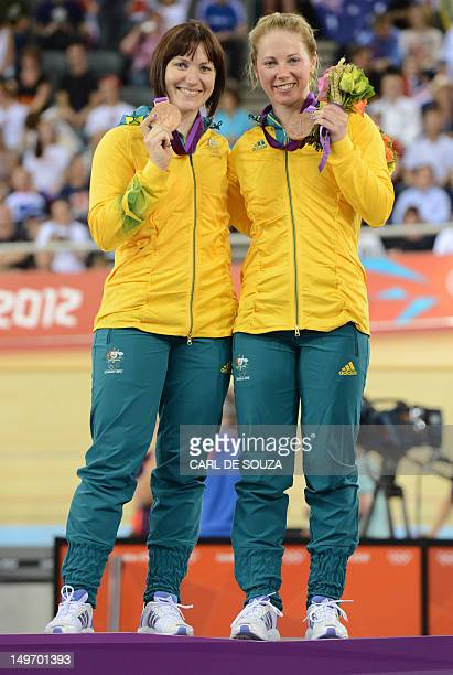 Australia's Anna Meares and Australia's Kaarle Mcculloch celebrate their bronze medal during the podium ceremony for the Women's team sprint as part...