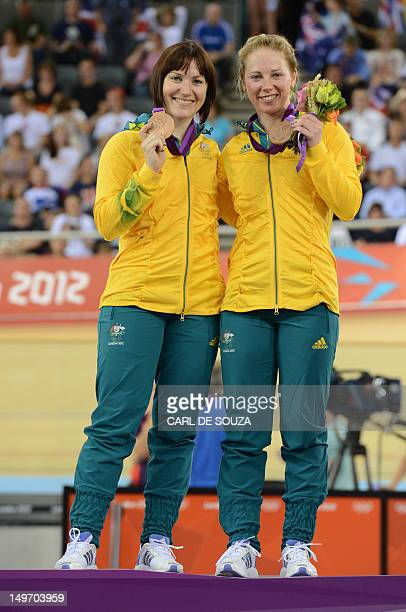 Australia's Anna Meares and Australia's Kaarle Mcculloch pose with their bronze medal on the podium of the Women's team sprint track cycling event of...