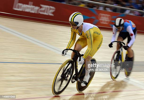 Australia's Anna Meares and Canada's Monique Sullivan compete in the London 2012 Olympic Games women's sprint round of eight cycling event at the...