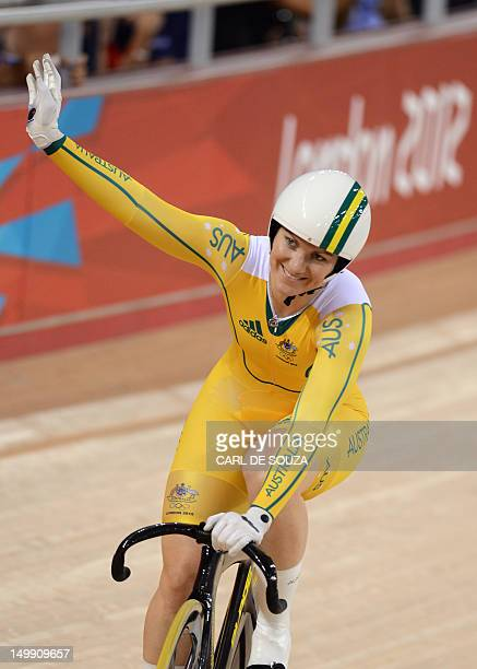 Australia's Anna Meares celebrates after crossing the finish line ahead of Ukraine's Lyubov Shulika during the London 2012 Olympic Games women's...