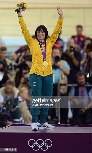 Australia's Anna Meares celebrates on the podium after winning the gold medal in the London 2012 Olympic Games women's sprint final cycling event at...