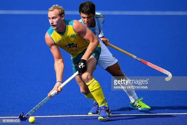 Australia's Aran Zalewski vies for the ball with Isidoro Ibarra of Argentina during their men's field hockey match of the 2018 Sultan Azlan Shah...