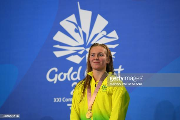 Australia's Ariarne Titmus poses with her gold medal after winning the swimming women's 800m freestyle final during the 2018 Gold Coast Commonwealth...