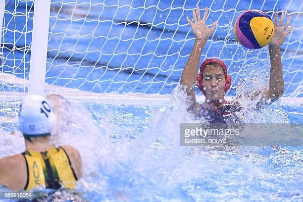 Australia's Ash Southern vies for the ball with Hungary's goalie Orsolya Kaso during their Rio 2016 Olympic Games waterpolo qauerterfinal match at...