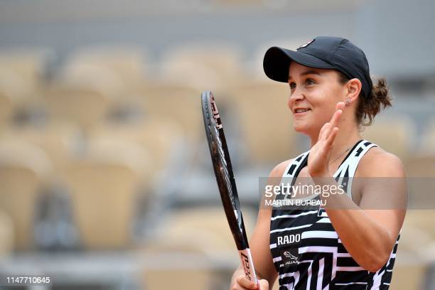 Australia's Ashleigh Barty applauds as she celebrates after winning against Sofia Kenin of the US during their women's singles fourth round match on...
