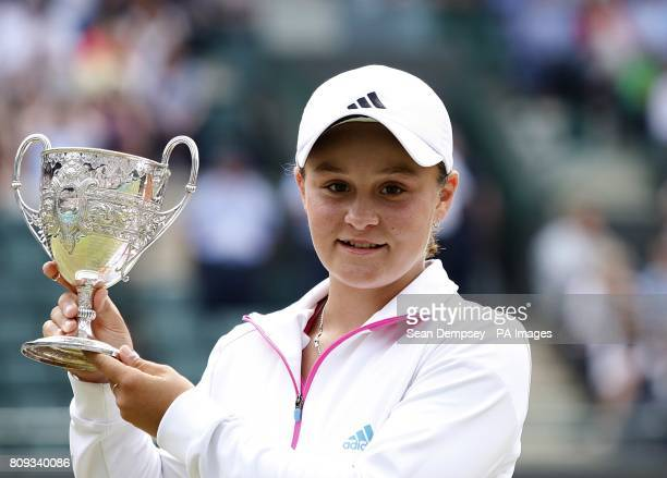 Australia's Ashleigh Barty celebrates with her trophy after defeating Russia's Irina Khromacheva in the Girls' Singles Final on day thirteen of the...
