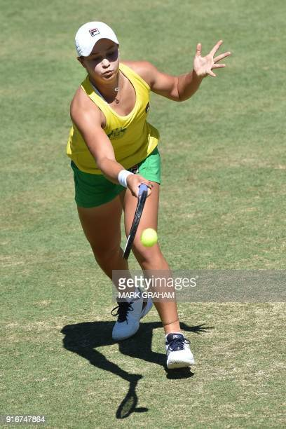 Australia's Ashleigh Barty hits a return against Ukraine's Marta Kostyuk in their women's reverse singles Federation Cup tennis match in Canberra on...