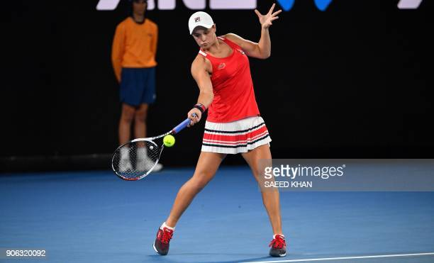 Australia's Ashleigh Barty hits a return during their women's singles second round match against Italy's Camila Giorgi on day four of the Australian...