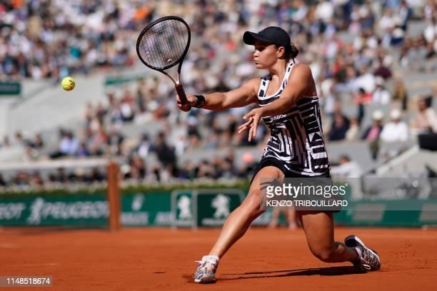 TOPSHOT Australia's Ashleigh Barty plays a backhand return to Czech Republic's Marketa Vondrousova during their women's singles final match on day...