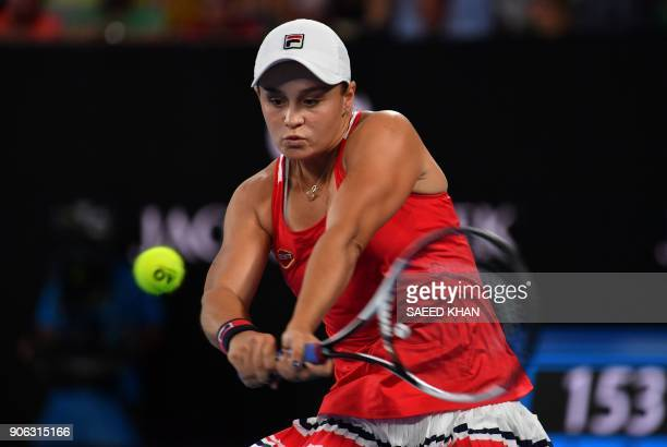 Australia's Ashleigh Barty plays a backhand return to Italy's Camila Giorgi during their women's singles second round match on day four of the...