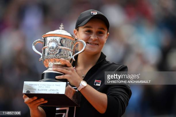 TOPSHOT Australia's Ashleigh Barty poses with the trophy Suzanne Lenglen after winning against Czech Republic's Marketa Vondrousova at the end of the...