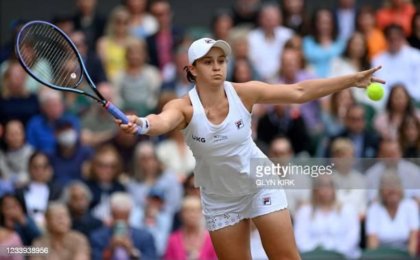 Australia's Ashleigh Barty returns against Czech Republic's Karolina Pliskova during their women's singles final match on the twelfth day of the 2021...