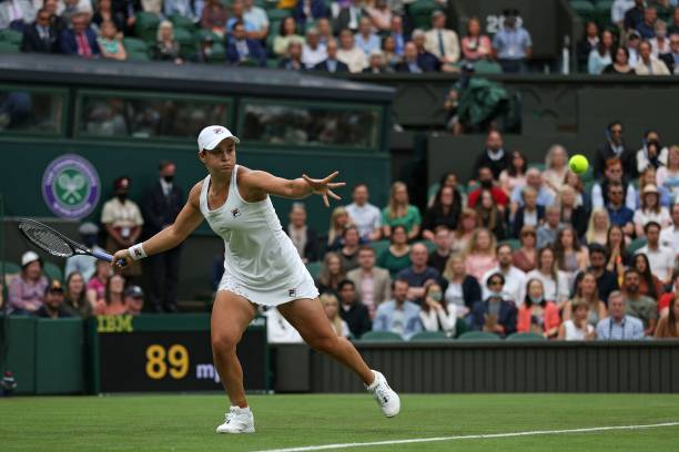 Australia's Ashleigh Barty returns against Spain's Carla Suarez Navarro during their women's singles first round match on the second day of the 2021...