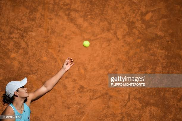 Australia's Ashleigh Barty serves to Russia's Veronika Kudermetova during their match of the Women's Italian Open at Foro Italico on May 13, 2021 in...