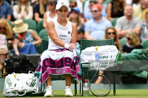 Australia's Ashleigh Barty sits in the break between games against China's Zheng Saisai during their women's singles first round match on the second...
