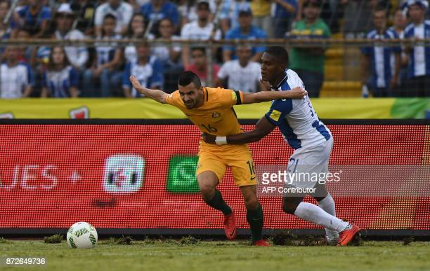 Australia's Aziz Behich is grabbed by Honduras' Brayan Beckeles during the first leg football match of their 2018 World Cup qualifying playoff in San...