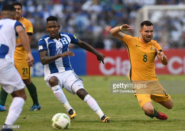 Australia's Bailey Wright falls next to Honduras' Romell Quioto during the first leg football match of their 2018 World Cup qualifying playoff in San...