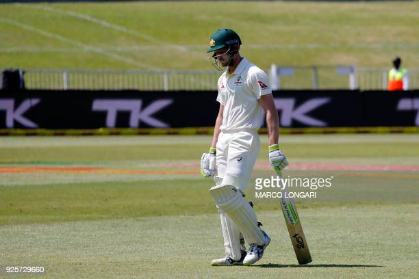 Australia's batsman Cameron Bancroft leaves after being dismissed by a ball delivered by South Africa bowler Vernon Philander during day one of the...