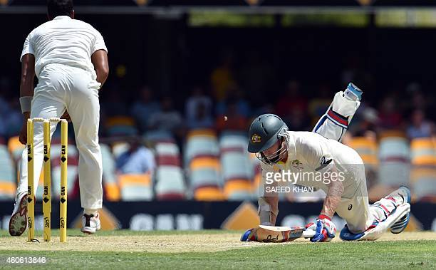 Australia's batsman Chris Rogers dives to gain his ground successfully on the second day of the 2nd Test match between Australia and India at The...
