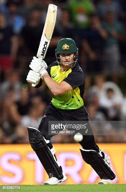 Australia's batsman D'Arcy Short drives a ball from the England bowling during their Twenty20 cricket match at Bellerive Oval in Hobart on February 7...