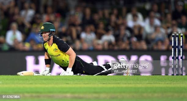 Australia's batsman D'Arcy Short falls after playing a shot from the England bowling during their Twenty20 cricket match at Bellerive Oval in Hobart...