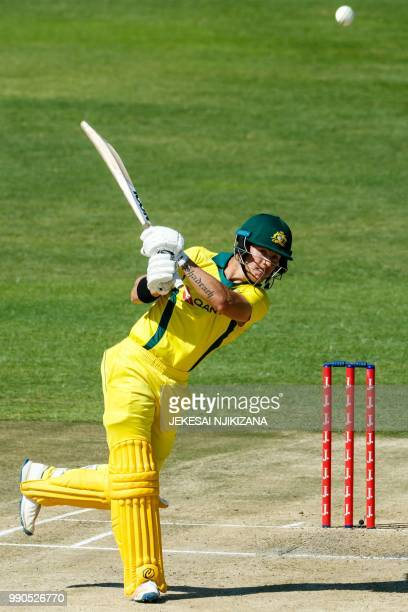 Australia's batsman D'Arcy Short plays a shot during the third match played between Australia and hosts Zimbabwe as part of a T20 triseries which...