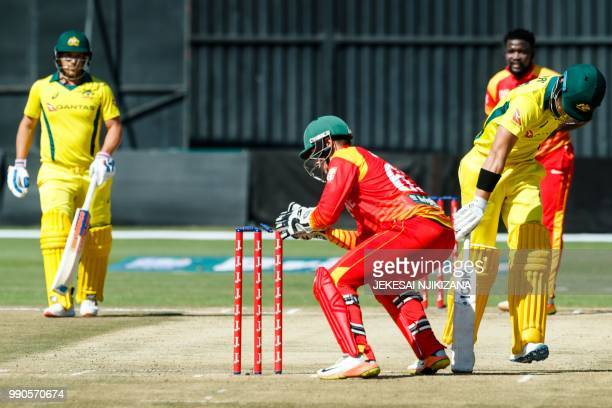 Australia's batsman D'Arcy Short survives a run out attempt by wicket keeper PJ Moor during the third match played between Australia and hosts...