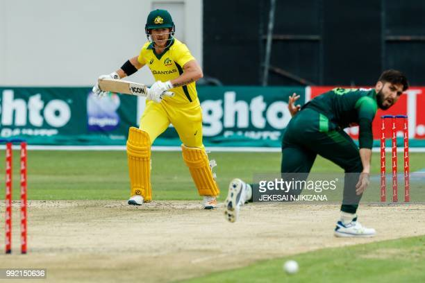 Australia's batsman D'Arcy Short watches the ball after playing a shot during the fifth T20 cricket match between Pakistan and Australia of a T20...
