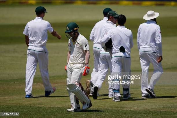 Australia's batsman David Warner leaves the ground after being dismissed by South Africa bowler Vernon Philander during day one of the first Sunfoil...