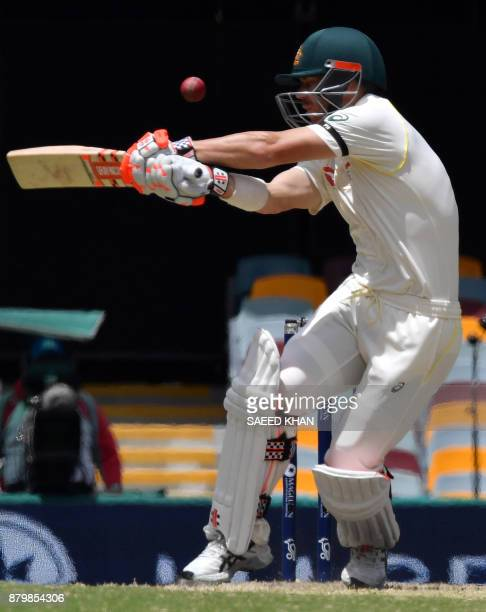 Australia's batsman David Warner plays a shot off England's paceman Jake Ball on the final day's play of the first cricket Ashes Test between England...