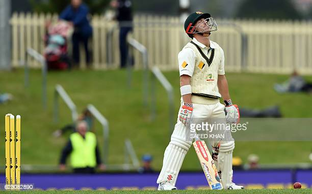 Australia's batsman David Warner reacts as he is bowled by South Africa's Kyle Abbott on the third day's play of the second Test cricket match...