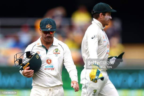 Australia's batsman David Warner walks back to his fielding position on day five of the fourth cricket Test match between Australia and India at The...