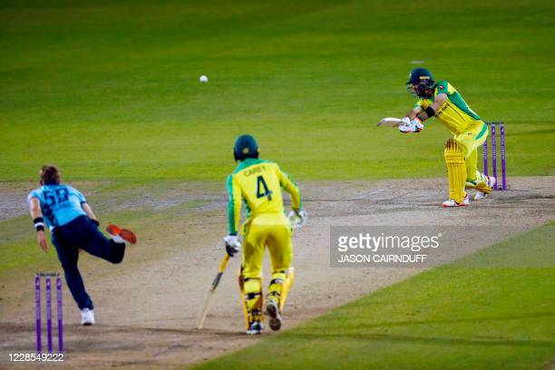 Australia's batsman Glenn Maxwell hits a shot to score four runs off the bowling of England's Tom Curran during the one-day international cricket...