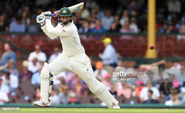 Australia's batsman Matt Renshaw cuts a ball away from the Pakistan bowling during the first day of the third cricket Test match at the SCG in Sydney...