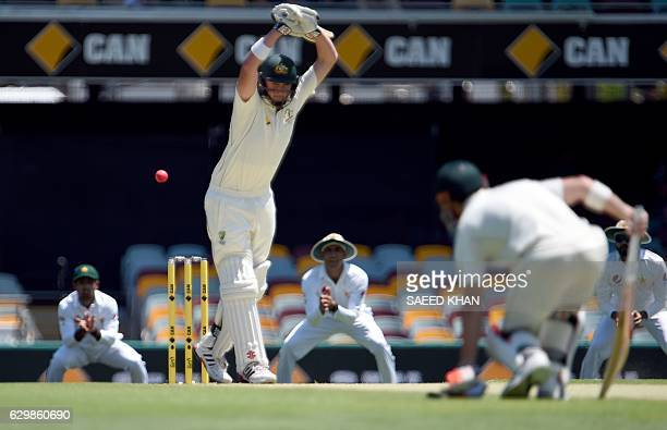 Australia's batsman Matt Renshaw leaves a ball during the first day and night Test between between Australia and Pakistan at Gabba statdium in...