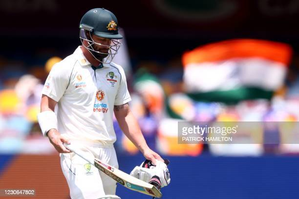 Australia's batsman Matthew Wade departs after his dismissal off India's paceman Mohammed Siraj on day four of the fourth cricket Test match between...