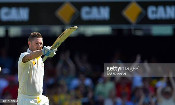 Australia's batsman Michael Clarke celebrates his 100 runs during day three of the first Ashes cricket Test match between England and Australia at...