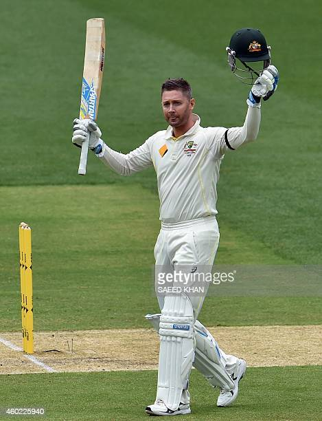 Australia's batsman Michael Clarke celebrates his century on the second day of the first Test cricket match between Australia and India at the...