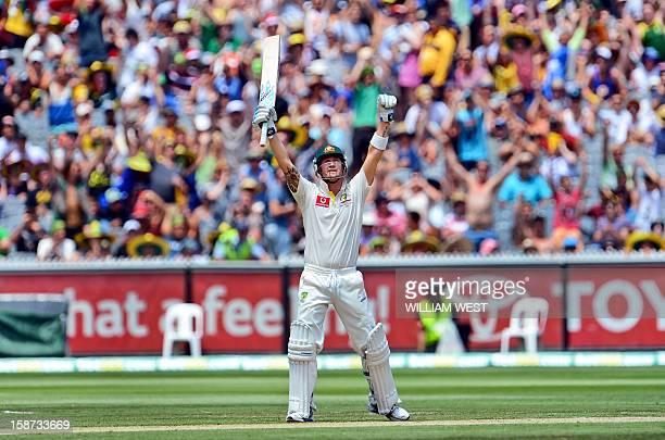 Australia'S batsman Michael Clarke celebrates scoring his century against Sri Lanka on the second day of the second cricket Test match at the...
