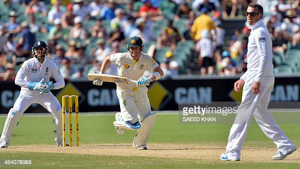 Australia's batsman Michael Clarke runs for a quick single as England's wicketkeeper Matt Prior looks on during the third day of the second Ashes...