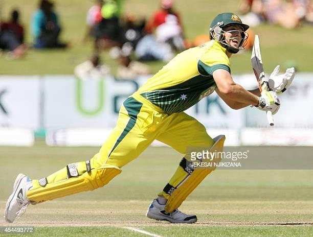 Australia's batsman Mitchell Marsh plays a shot during a oneday international triangular series cricket match between Australia and South Africa at...
