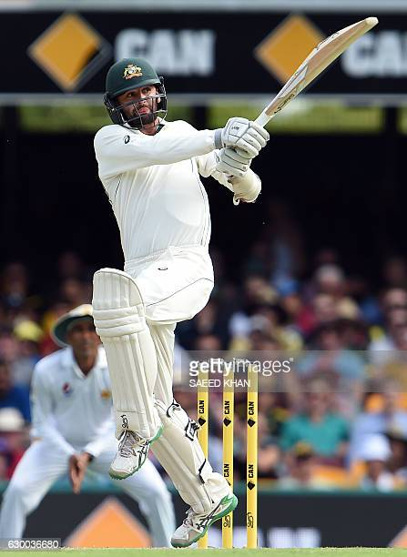 Australia's batsman Nathan Lyon plays a shot during the second day of the daynight cricket Test match between Australia and Pakistan at the Gabba in...
