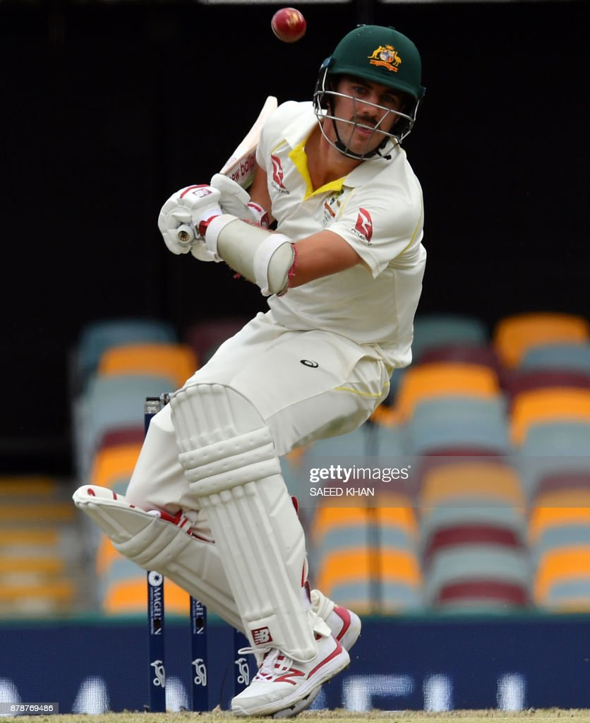 Australia's batsman Pat Cummins gets away from the line of a ball on the third day of the first cricket Ashes Test between England and Australia in Brisbane on November 25, 2017. /