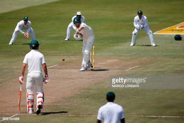 Australia's batsman Pat Cummins hits a ball delivered by South Africa bowler Vernon Philander during play on the second day two of the first Test...