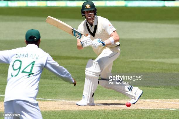 Australia's batsman Steve Smith plays a shot during the day two of the second cricket Test match between Australia and Pakistan in Adelaide on...