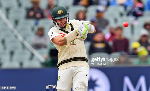 Australia's batsman Tim Paine pulls a ball from the England bowling on the second day of the second Ashes cricket Test match in Adelaide in December...